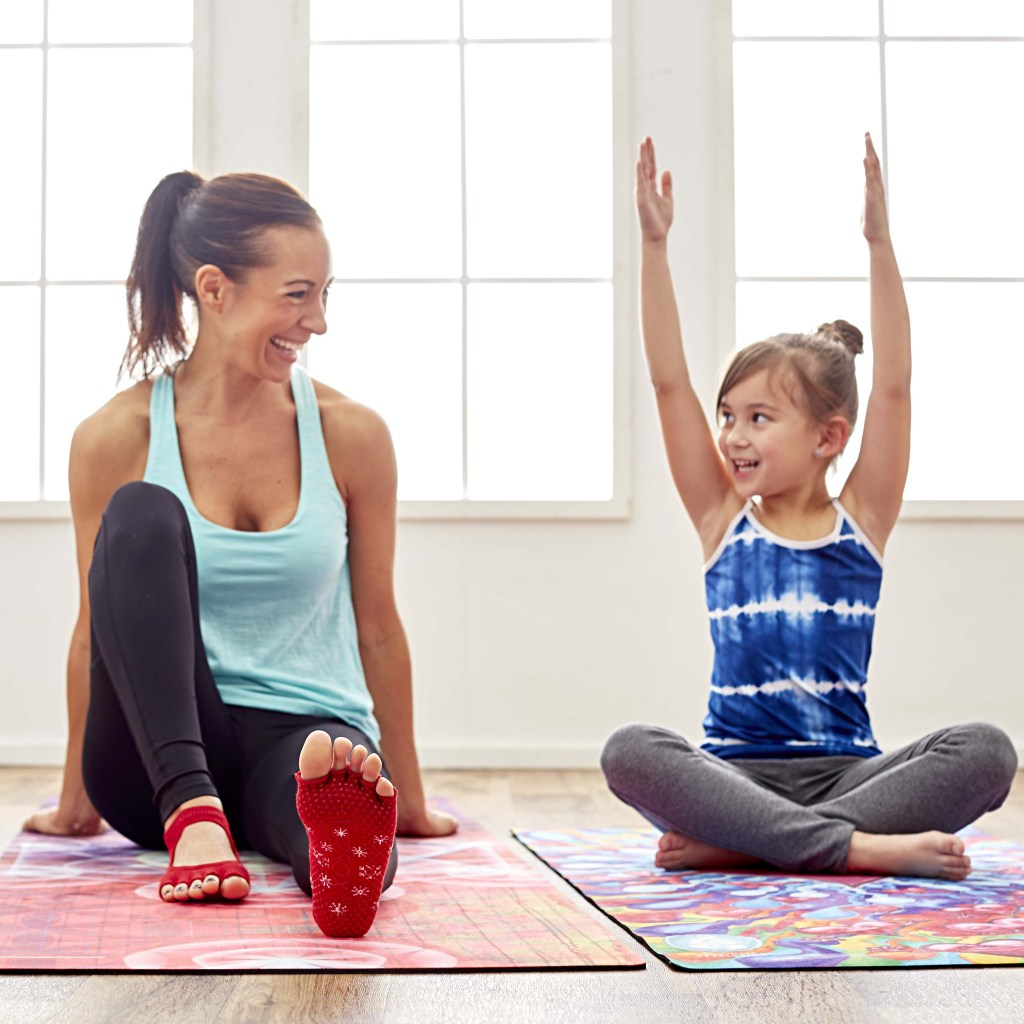 woman doing yoga with a child
