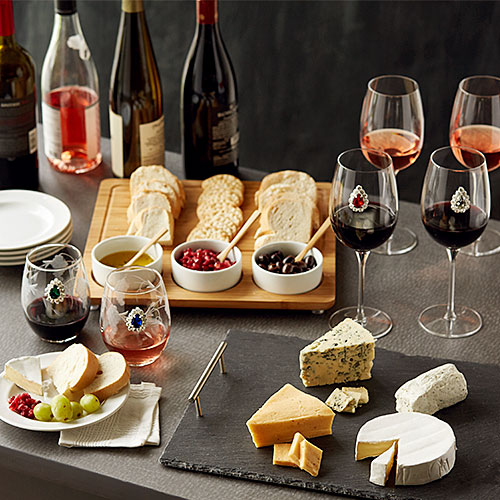 Wine glasses with different varieties of wine and appetizers