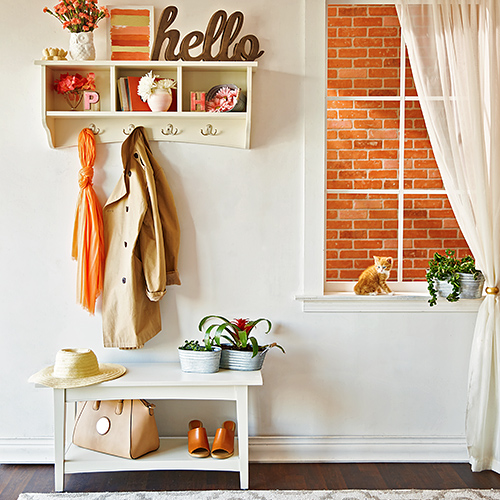 Entryway with hooks and signs
