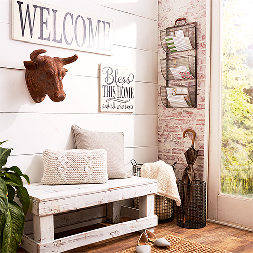 Entryway with baskets, pillows and bull art