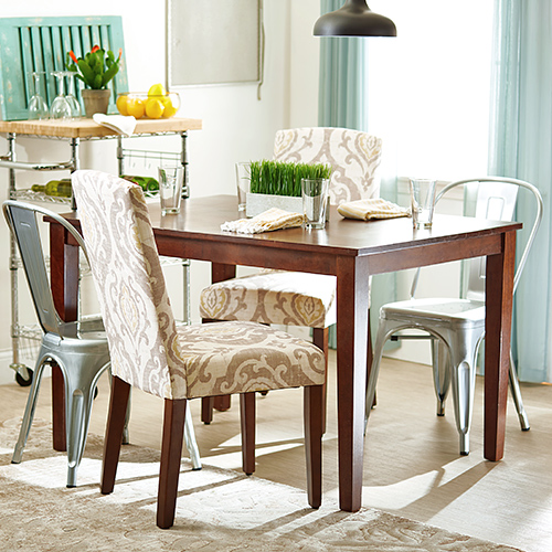 Mixed chairs around a dining table