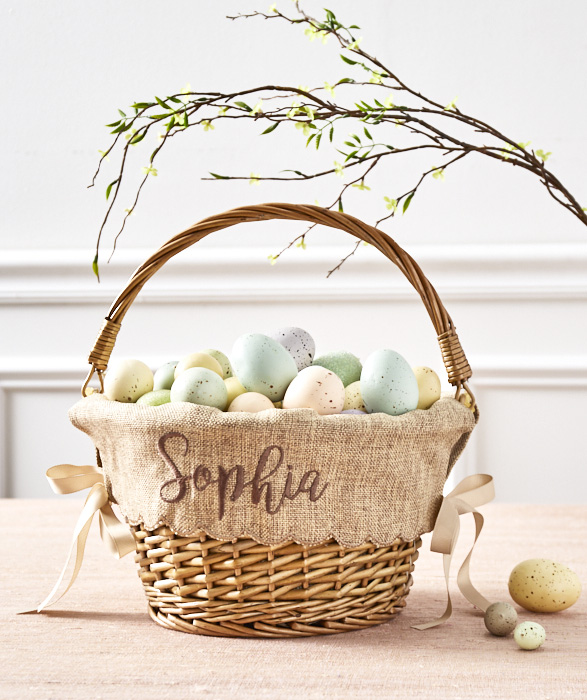 basket lined with burlap and filled with pastel-colored faux robin eggs