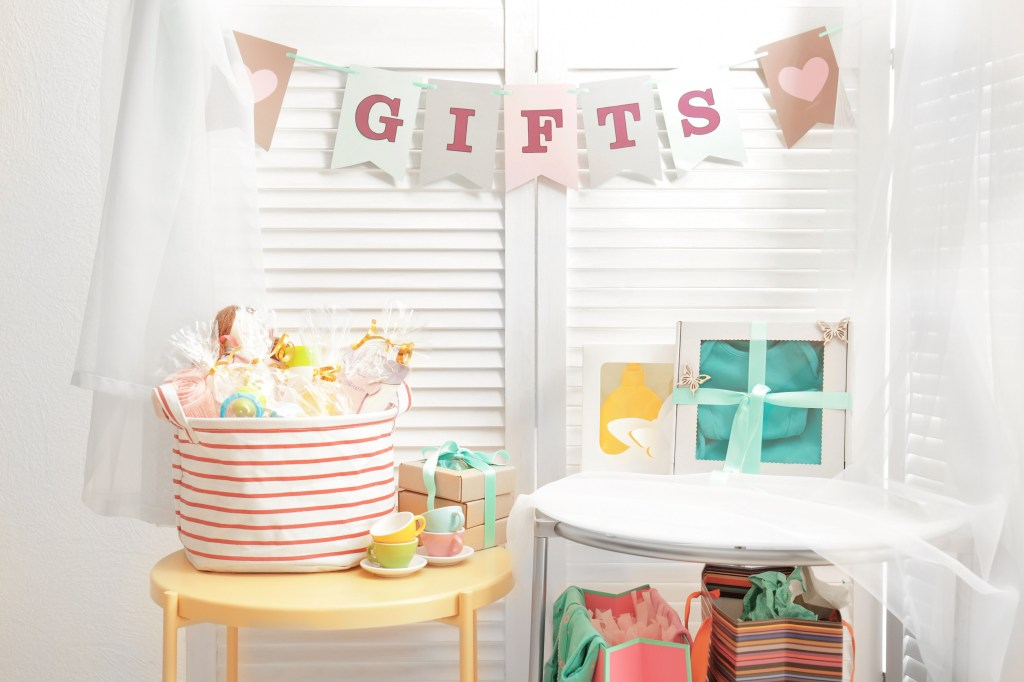 Gifts for baby shower party on tables indoors