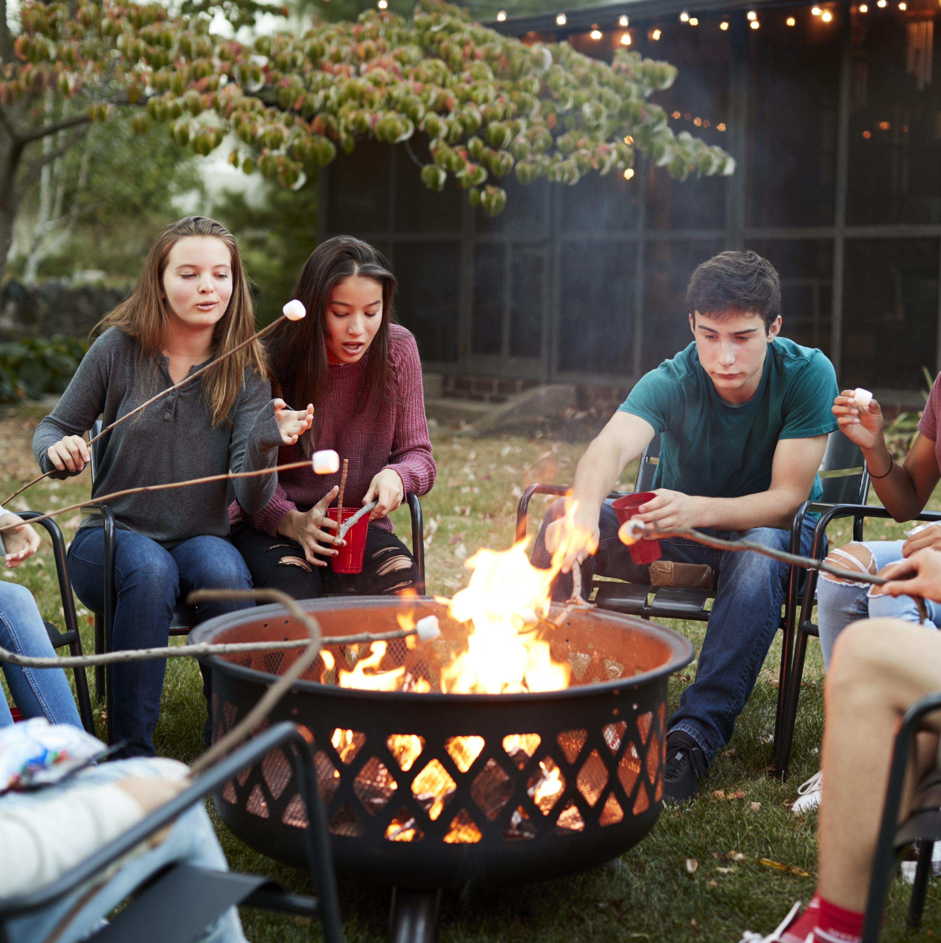 teens roasting marshmallows