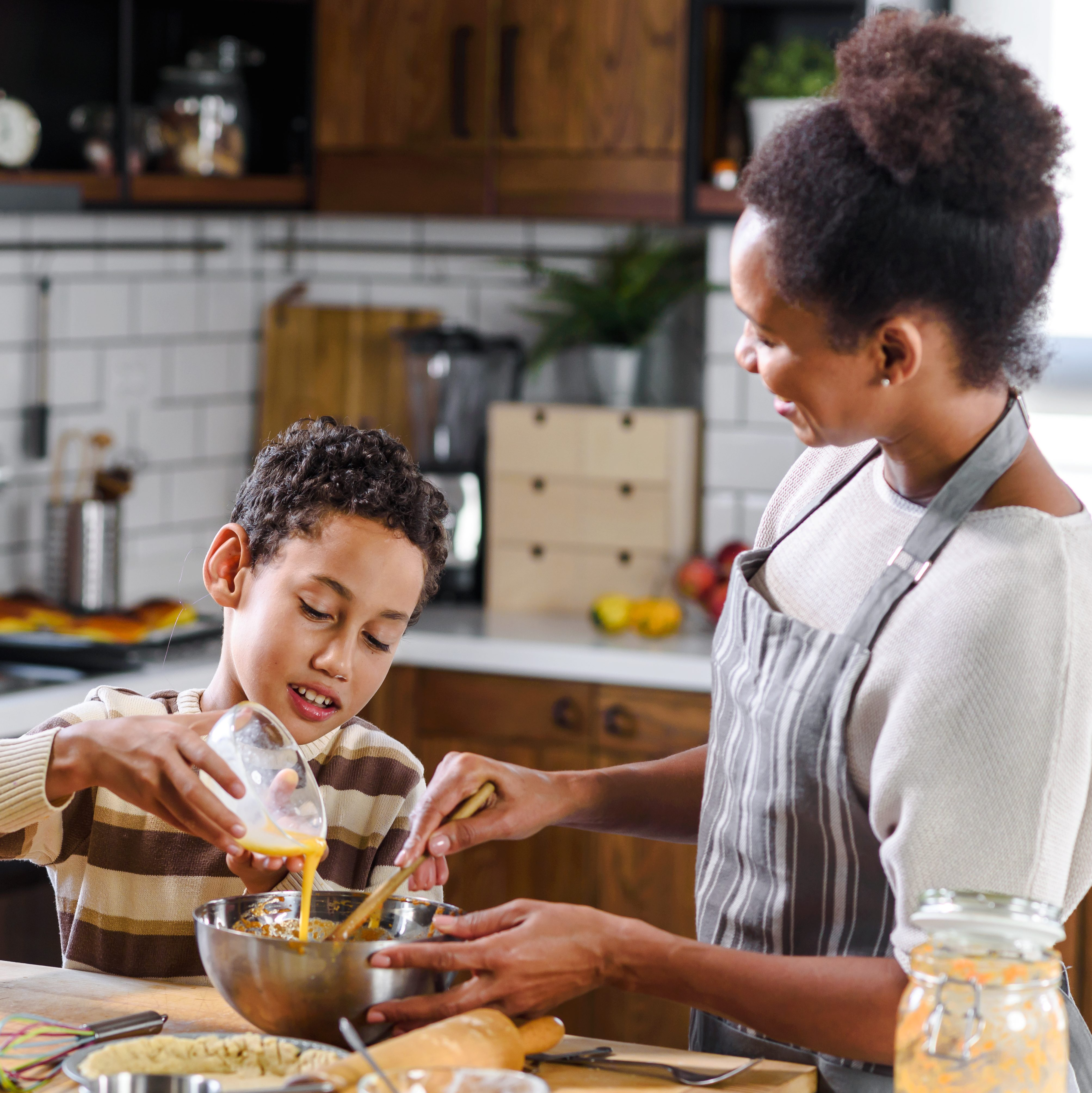 mom and child cooking