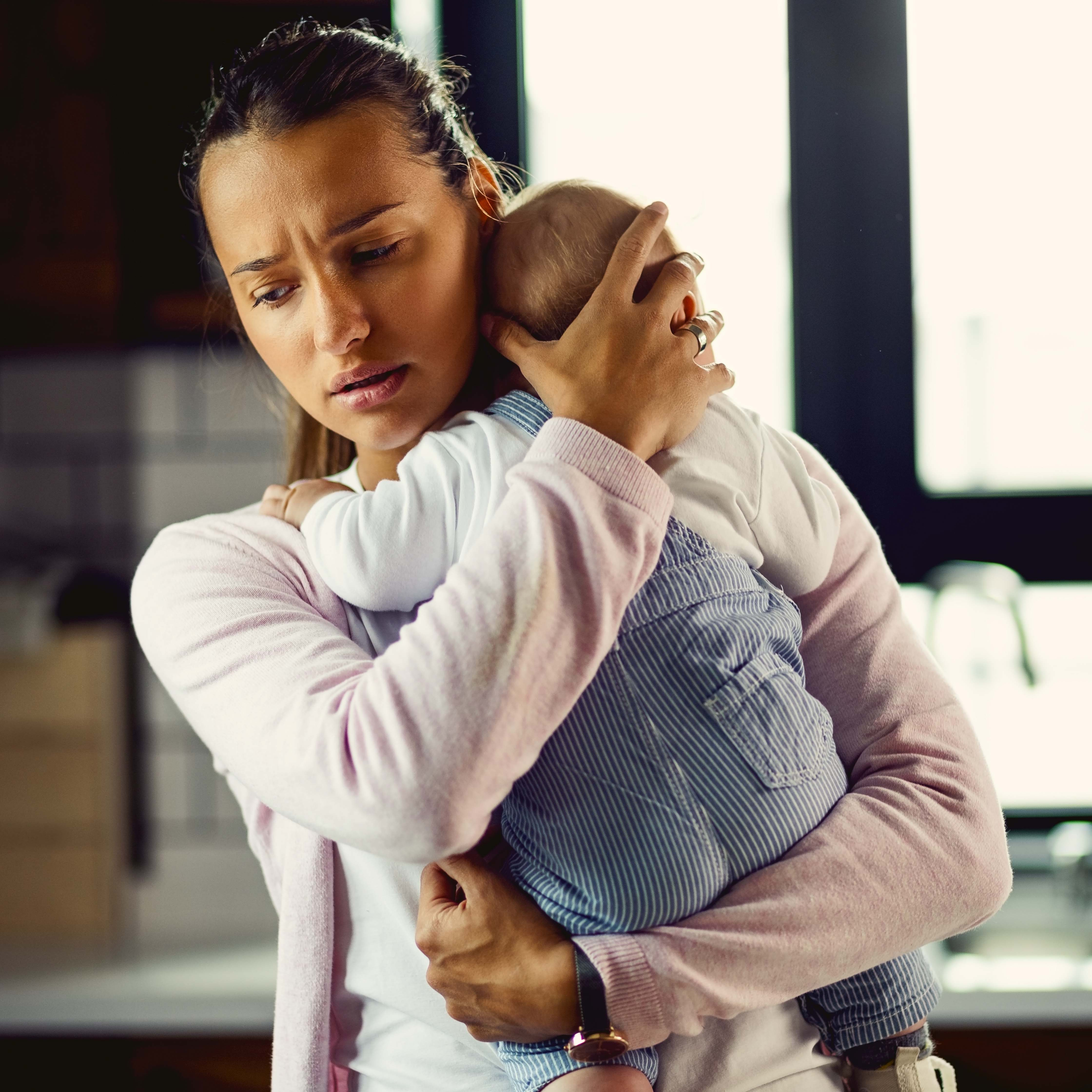 Worried mother with baby