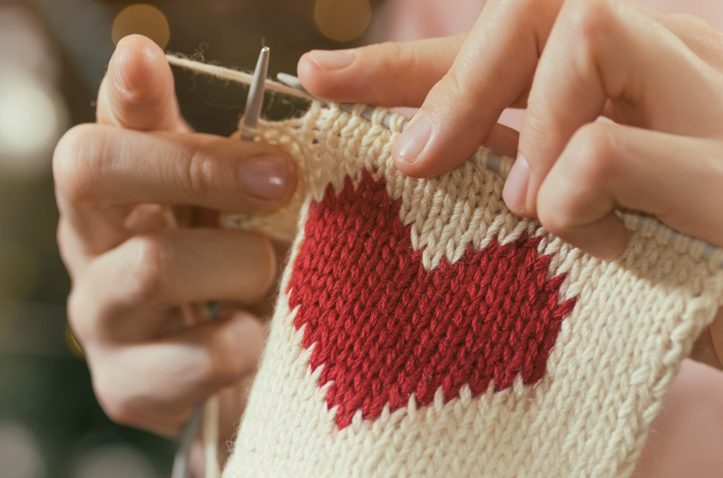 Knitting a blanket with a heart on it
