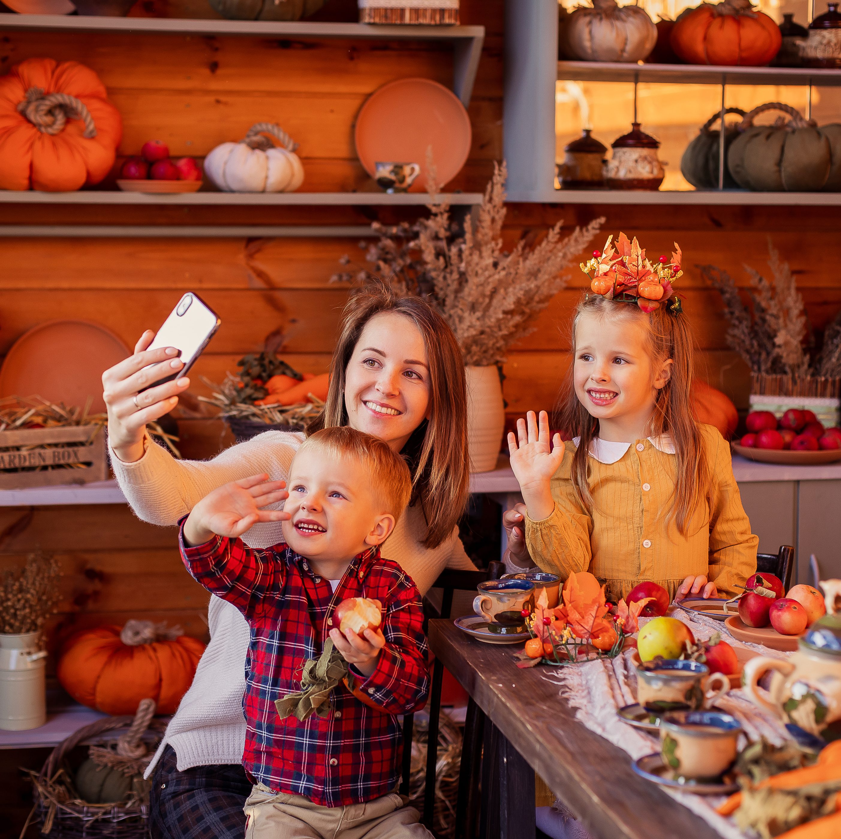 Mom and kids holding a virtual Thanksgiving