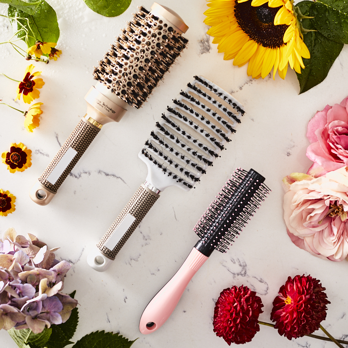 assortment of brushes and decorative flowers