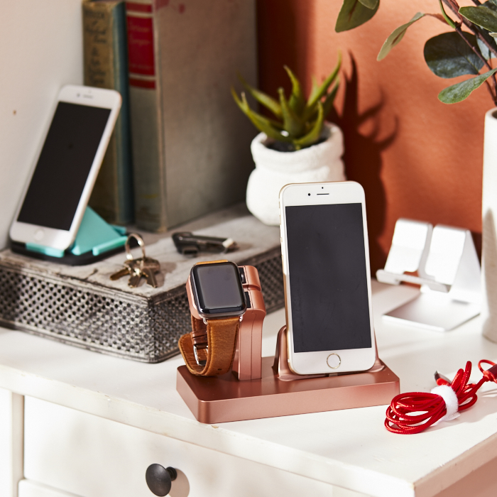 Desktop with charging stations for phones and watches, cables, portable USB sticks