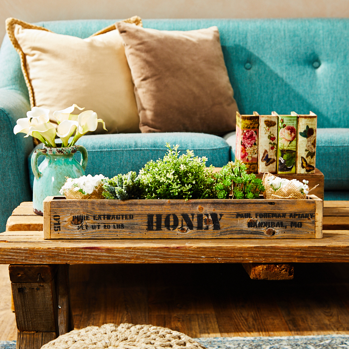 Reclaimed wood coffee table with repurposed crate as a planter tray