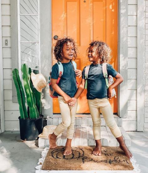 two kids in back-to-school outfits
