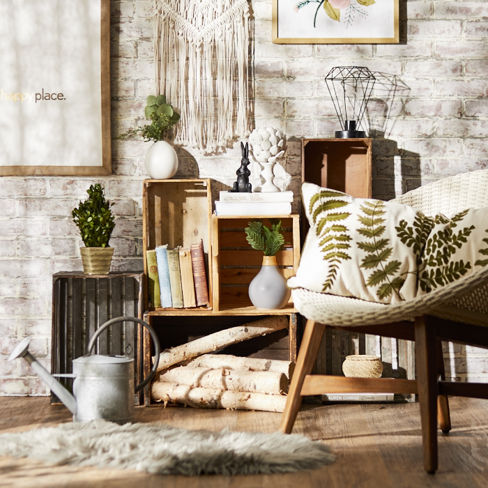 Neutral, nature-inspired decor with green fern-motif pillows and greenery