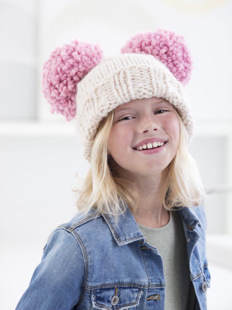 child in pompom-trim knit beanie