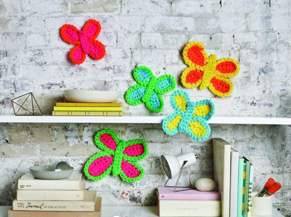crochet butterflies on shelf