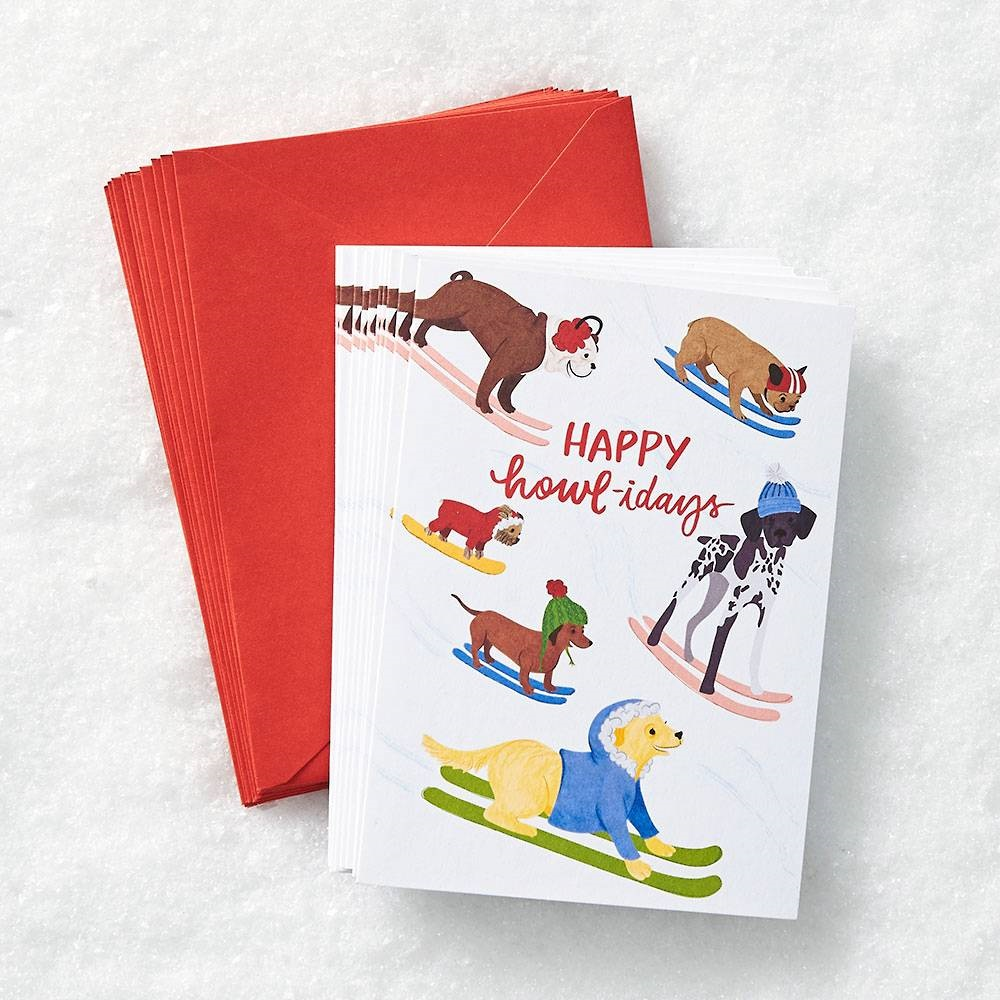 holiday card with skiing dogs