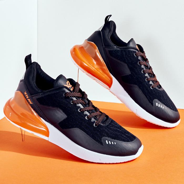 chunky-sole sneaker in black and orange