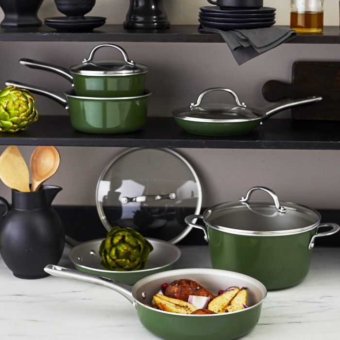 Green pots and pans on kitchen counter and shelves