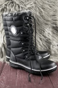 Winter boots with fur lining - essential for packing on a winter vacation.