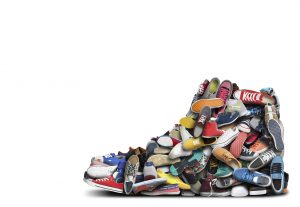 Collection of sneakers all shaped into one giant sneaker.