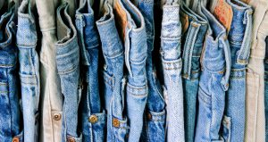A row of jeans hanging