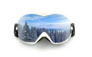 Ski goggles with mountain reflection isolated on white background